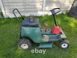 1973 Small vintage petrol ride on Garden lawn mower, grass cutter running, read