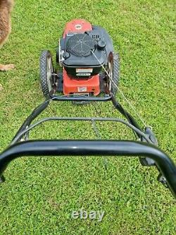 Ariens wheeled strimmer machine. Hardly used in excellent condition